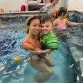 Smiles-with-volunteer-in-pool